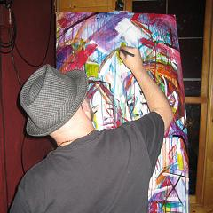 Scott West paints during the Wapsipinicon show at ArtOrg